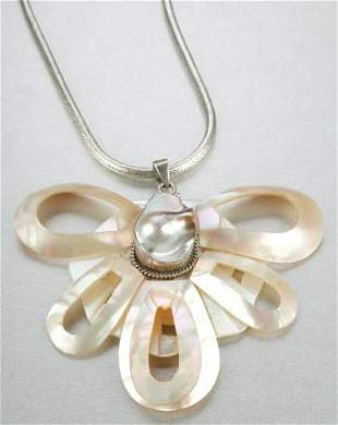 A STERLING SILVER, MOTHER OF PEARL AND BLISTER PEA