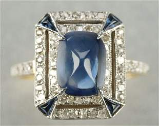 AN 18K GOLD, SAPPHIRE AND DIAMOND RING.