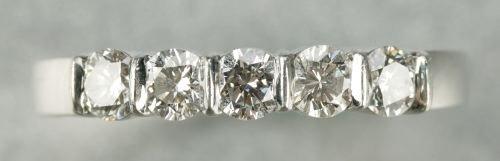 622: A PLATINUM AND DIAMOND BAND.