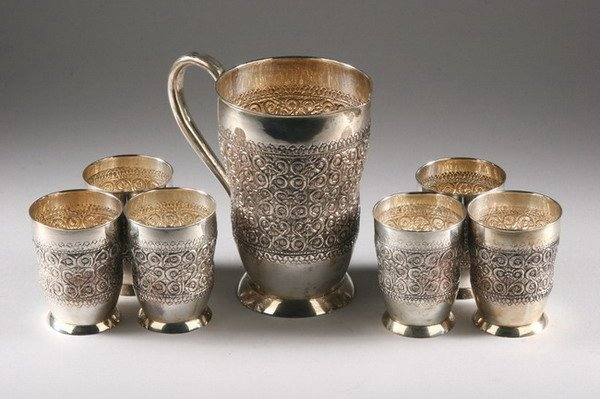 496: ANGLO-INDIAN SILVER REPOUSS? PITCHER AND SIX CUPS.
