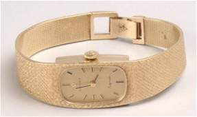 1293: LADY'S 14K YELLOW GOLD WRISTWATCH, SIGNED OMEGA.