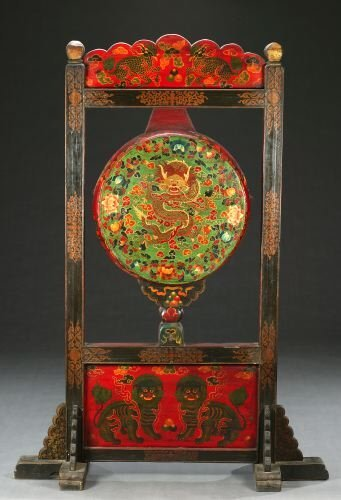816: A TIBETAN POLYCHROME WOOD AND LEATHER DRUM AND STA