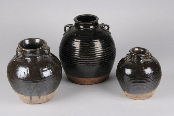 9: THREE CHINESE BROWN GLAZED STONE JARS. - 8 1/2 in. h
