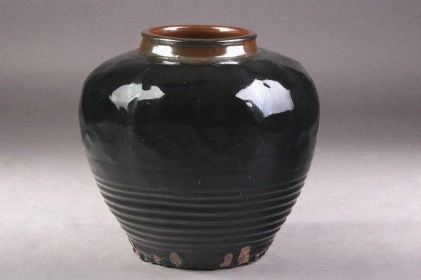 11: CHINESE BLACK GLAZED STONEWARE JAR. - 15 in. high.