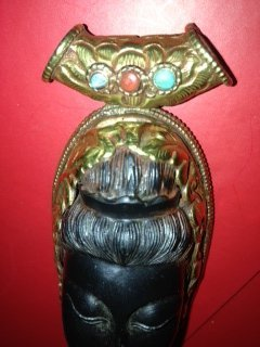 5: Wooden ebony carved Buddha pendent with gold metal b