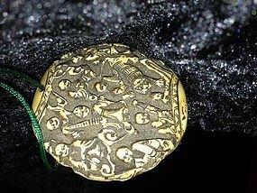 8: Many monks carved onto a round disc Tibetan origin