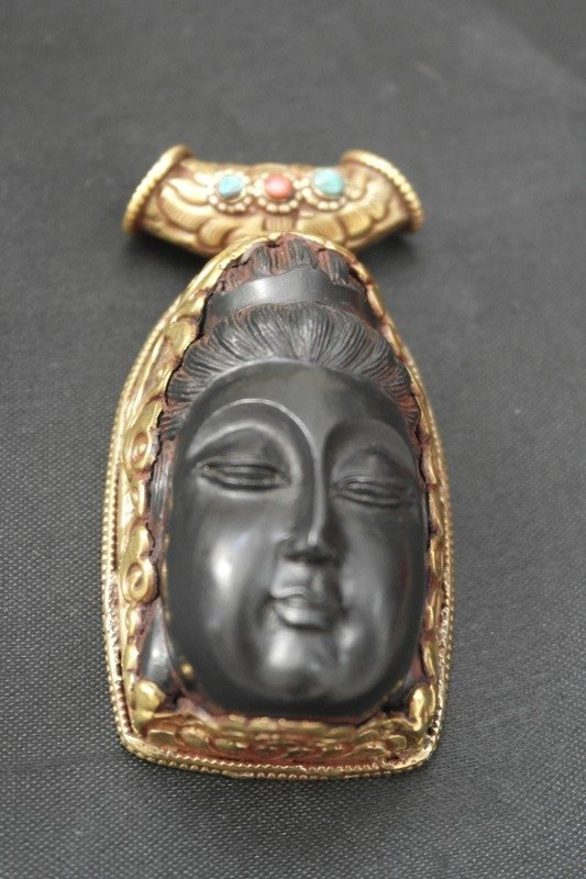 Wooden ebony carved Buddha pendent with gold metal back
