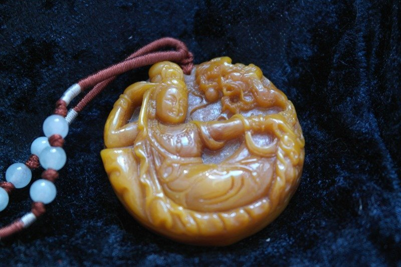 Tibetan kuan yin carved resin pendent