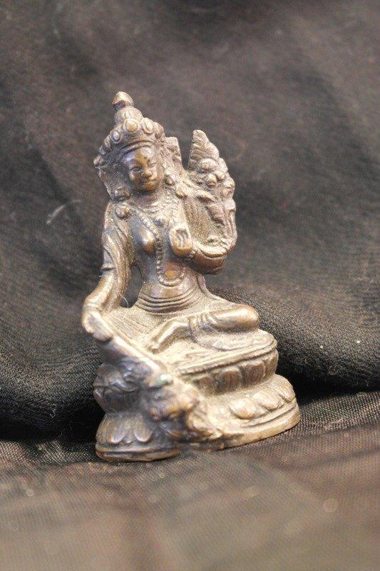 A bodhisattva kuan yin in bronze