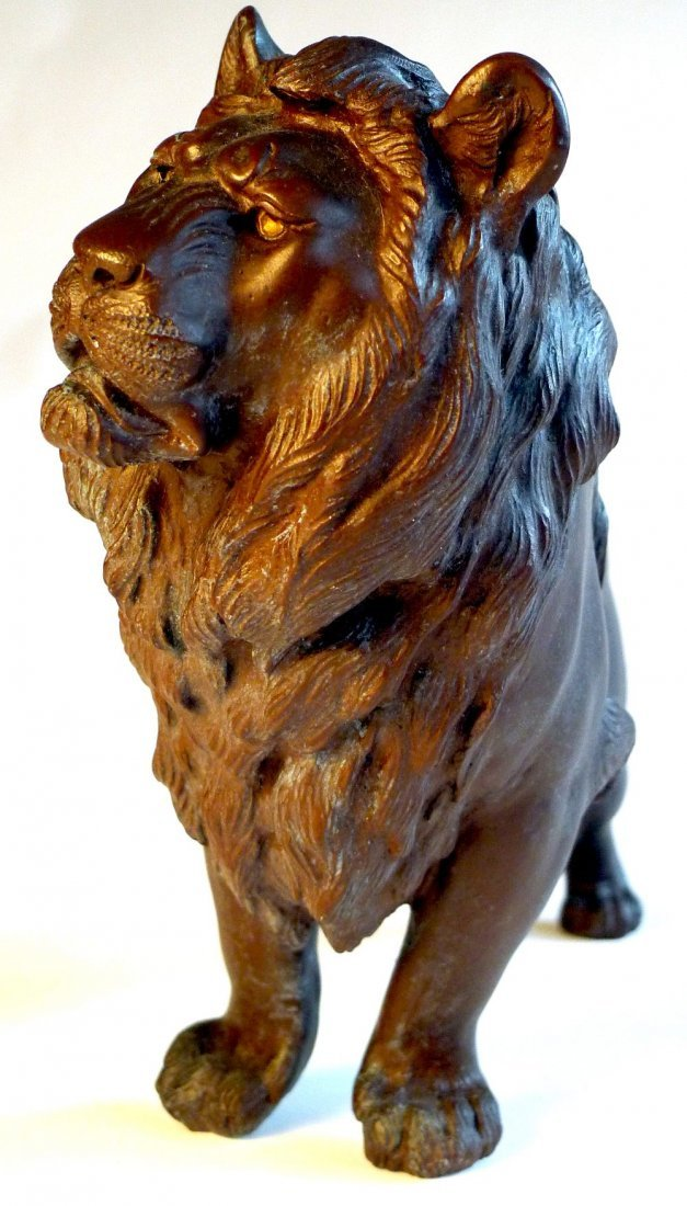 8: A late C19th Japanese bronze lion with signature to