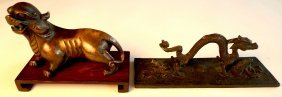18: An C18th/C19th Chinese bronze of a lion-dog on scro