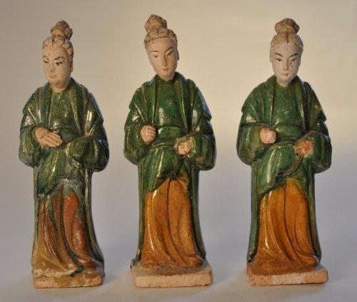 A set of three Chinese Ming Dynasty stone glazed figure
