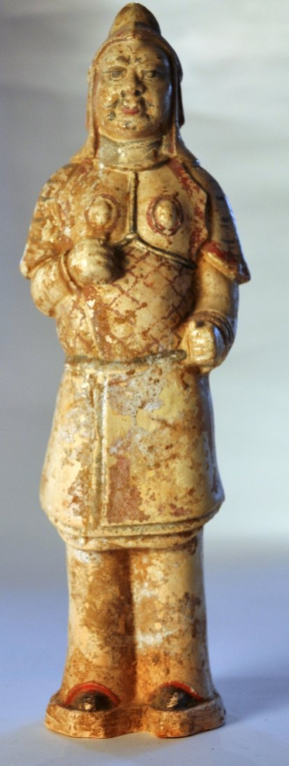 A Chinese Tang straw glazed pottery figure of a soldier