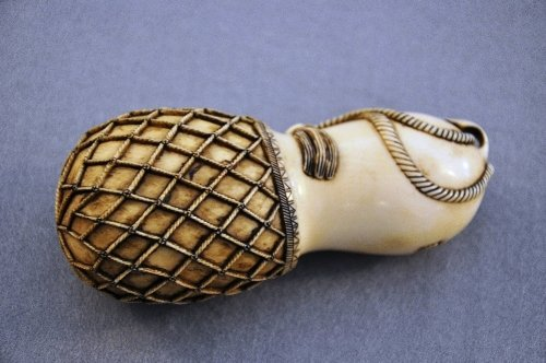 A Meiji period carved ivory dragon hatching from gourd