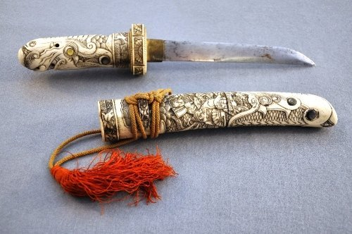 A Meiji period Japanese carved ivory Tanto sword dragon