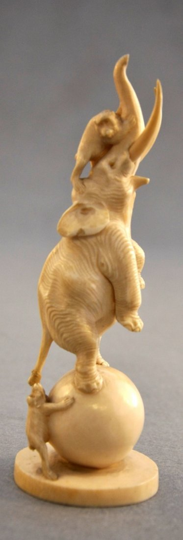 A Japanese Meiji period carved ivory of elephant on bal