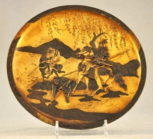 A Meiji period bronze and gilded charger with samurai
