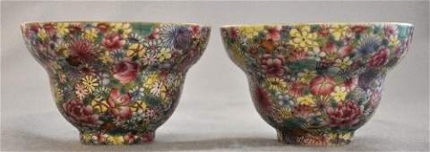 A pair of Chinese Qing Dynasty floral enamel bowls