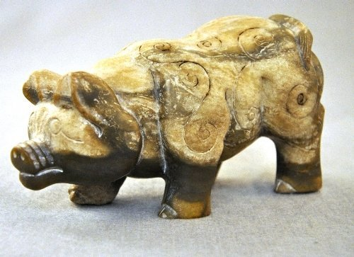 A Yin/Shang Dynasty Chinese jade carving of a pig 19 cm