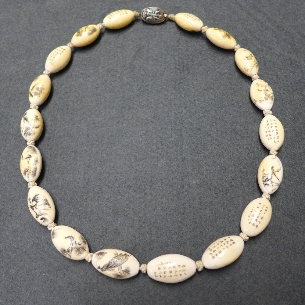 A C19th/ early C20th Chinese carved ivory bead necklace