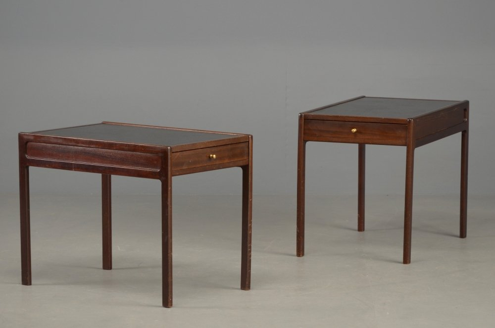A pair of narrow Danish mahogany bedside tables with bl