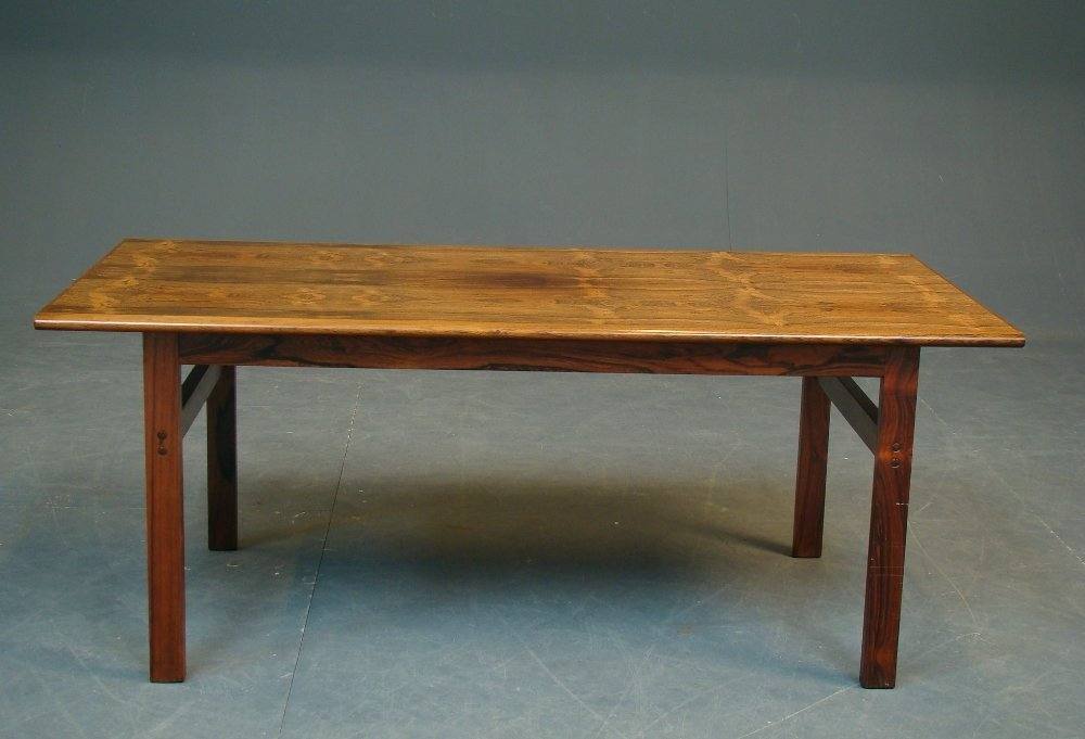 A Danish rosewood oblong coffee table designed by Illum