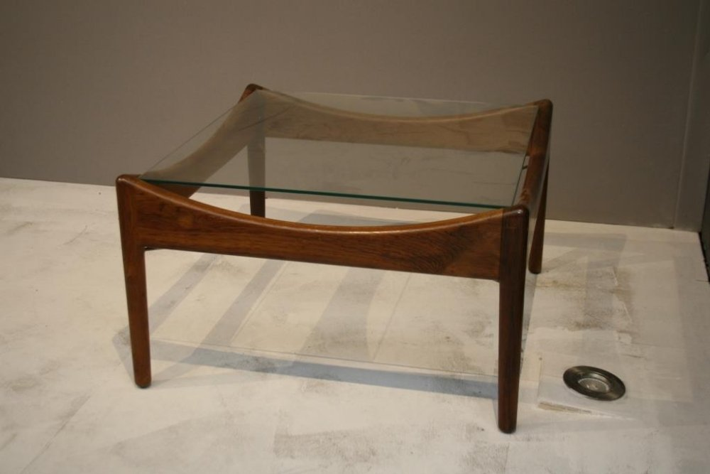 A Danish rosewood square low side table with glass top