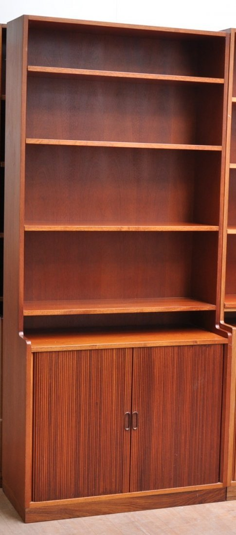 A Danish mahogany bookcase with roll-front cabinets. He