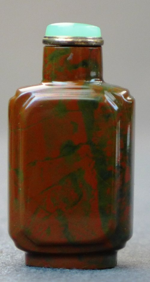 An 1800-1850 Chinese jasper snuff bottle of russet
