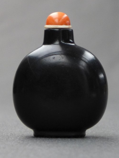 A 1780-1850 Chinese jet snuff bottle of large flattened