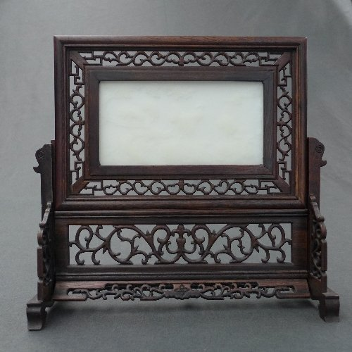 A C20th Chinese carved white jade screen with scenic