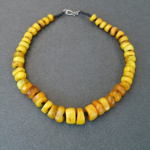An old Tibetan amber necklace with irregular beads  62g