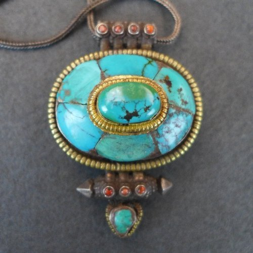 A late C19th Tibetan Gahu turquoise pillbox pendant