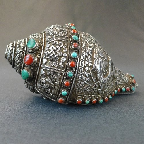 An C18th/early C19th Tibetan silver encrusted conch