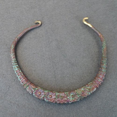 A C19th Timour bronze enamelled Torc wedding necklace