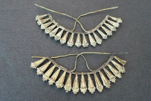 A pair of C10th Chinese silver gilt fan-shaped hair