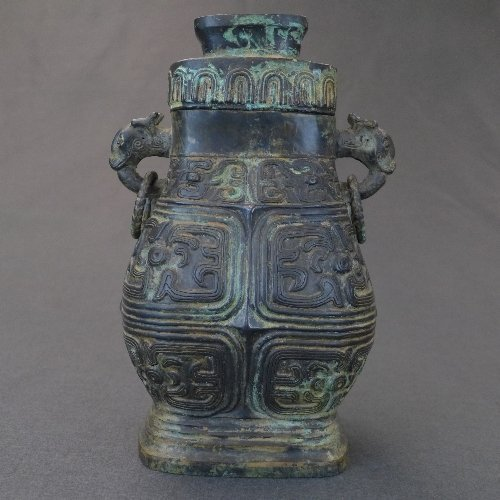 A Chinese Ming Dynasty bronze Hu vase and cover cast in