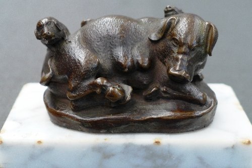 A C19th Oriental faux-bronze of a sow and piglets on