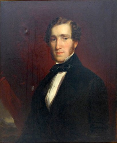 A Victorian oil on canvas portrait of a young gentleman