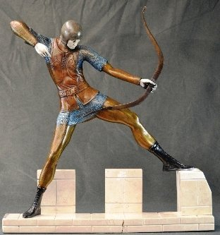 An Art Deco style bronze and ivory of a medieval archer
