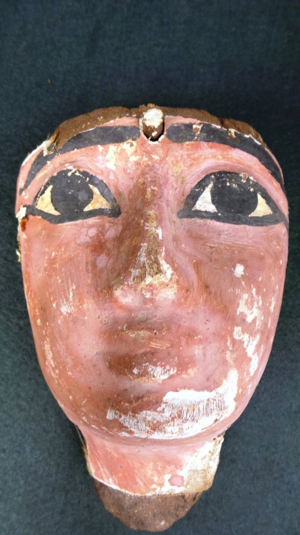 An Egyptian antiquity wooden painted mask with much ori