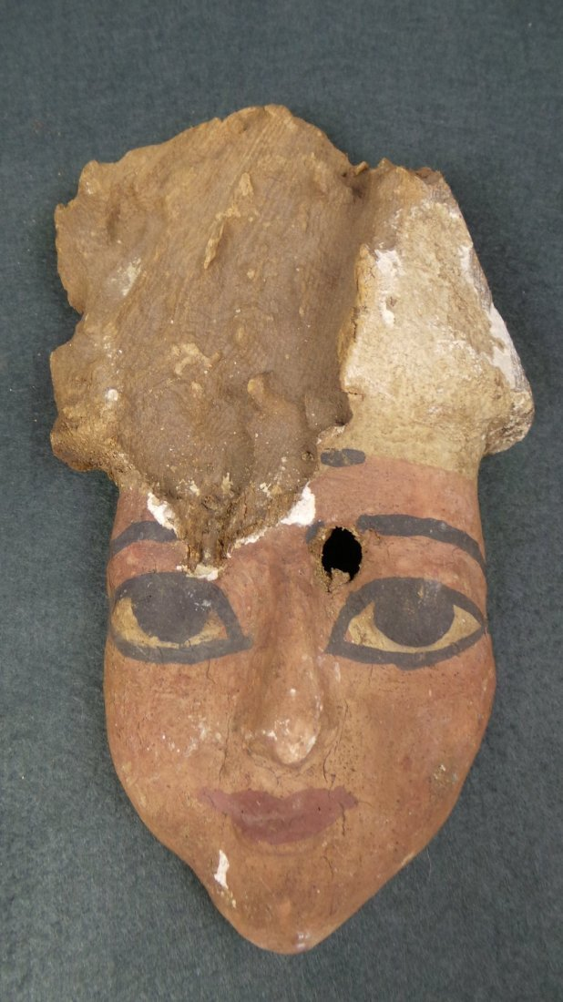 An Egyptian antiquity wooden painted mask with headdres