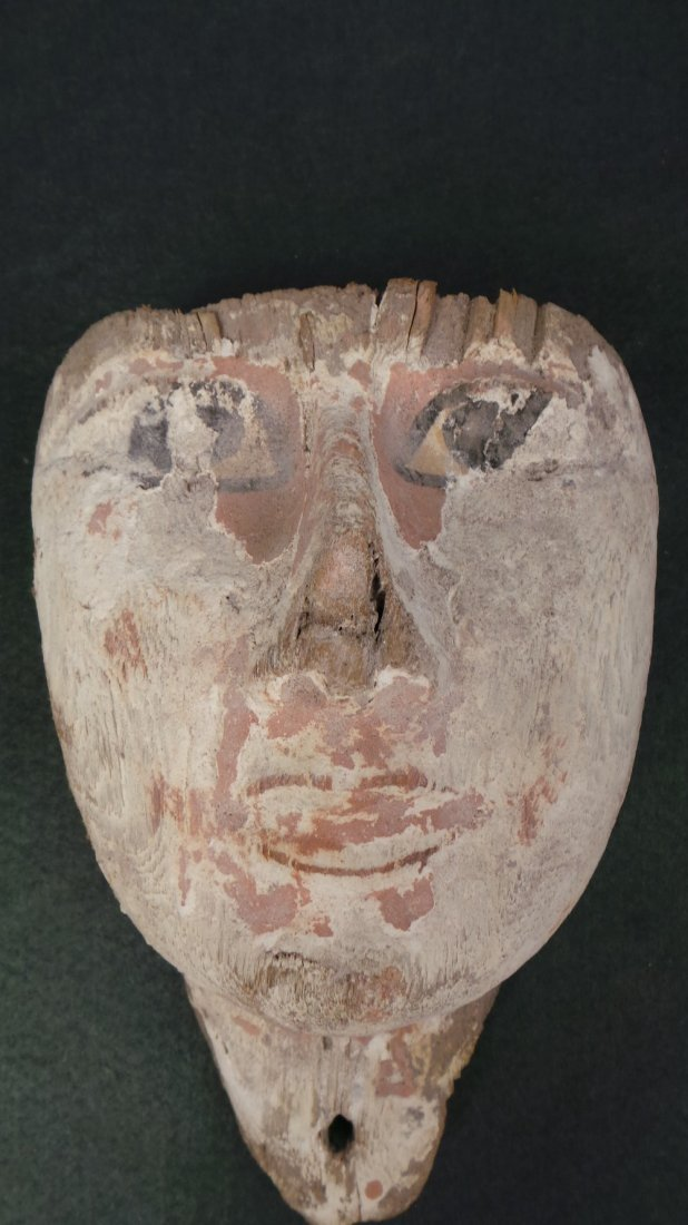 An Egyptian antiquity wooden painted mask with little o