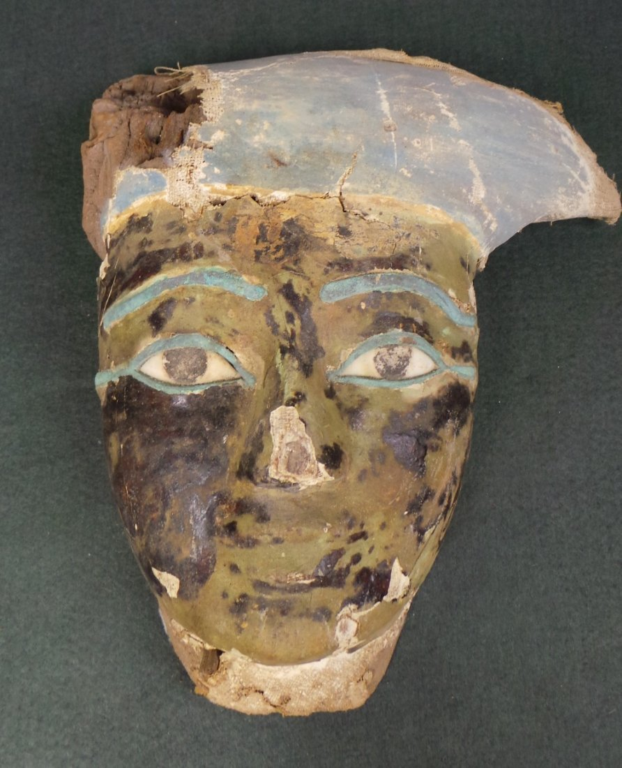 A large Egyptian antiquity wooden painted mask with hea