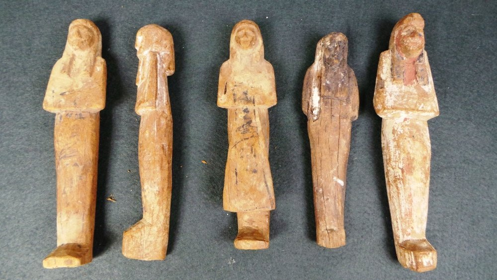 A collection of five Egyptian antiquity carved wooden S
