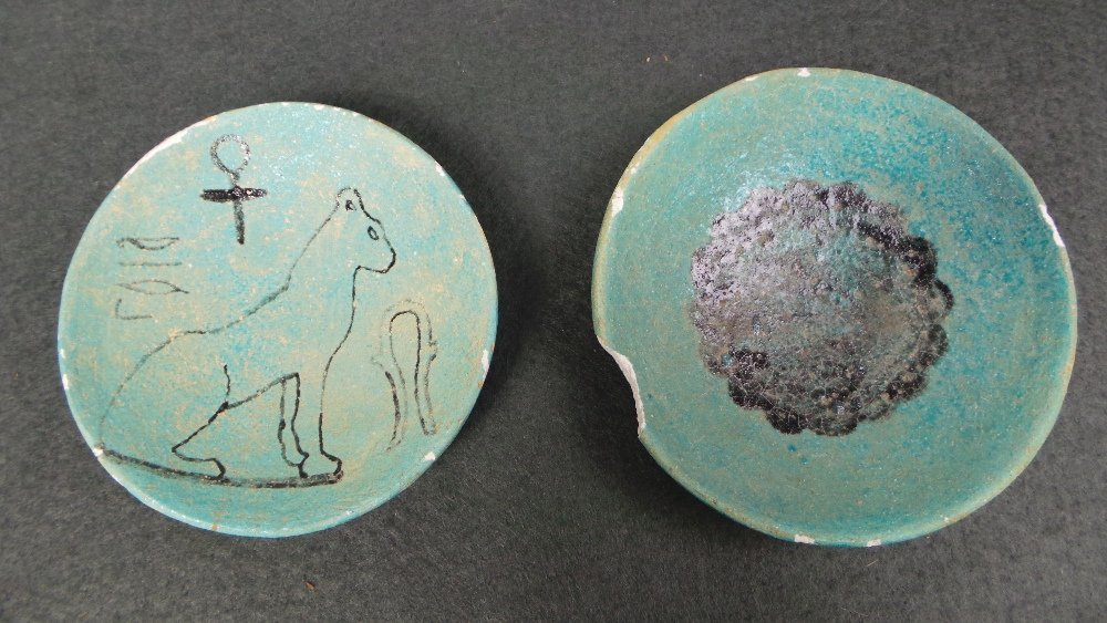 A pair of Egyptian antiquity Pharoic turquoise glazed p