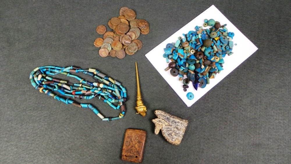 A collection of Egyptian antiquity glass beads, antiqui