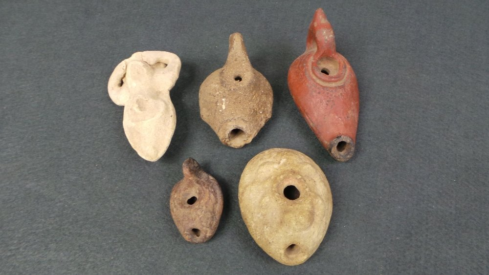 A collection of five antiquity pottery oil lamps