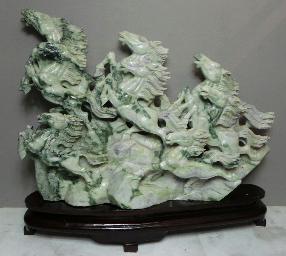An early C20th Chinese finely carved mottled celadon ja