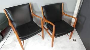 A pair of Finn Juhl Model 45 teak armchairs upholstered